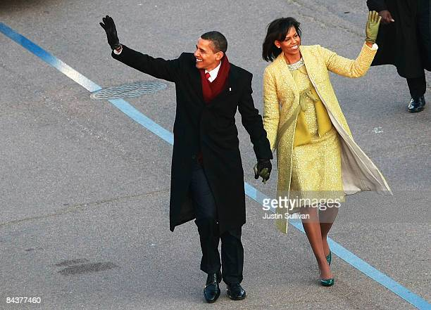 President Barack Obama and First Lady Michelle Obama arrive at the Presidential Reviewing Stand for the Inaugural Parade January 20, 2009 in...