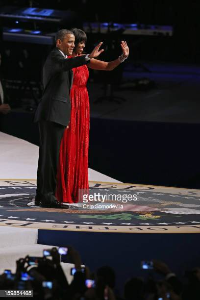 President Barack Obama and first lady Michelle Obama arrive for the Commander-In-Chief Ball at the Walter Washington Convention Center January 21,...