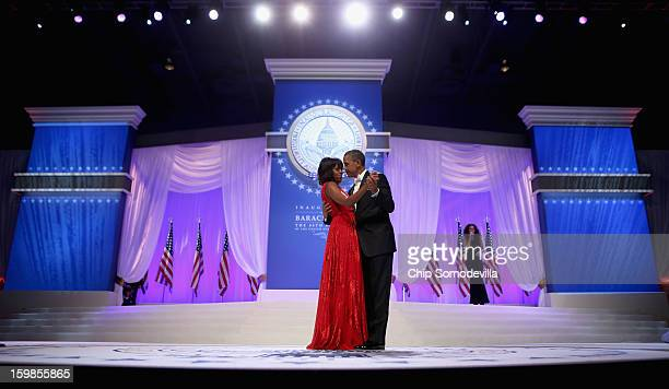 S President Barack Obama and first lady Michelle Obama arrive for the CommanderInChief's Ball at the Walter Washington Convention Center January 21...