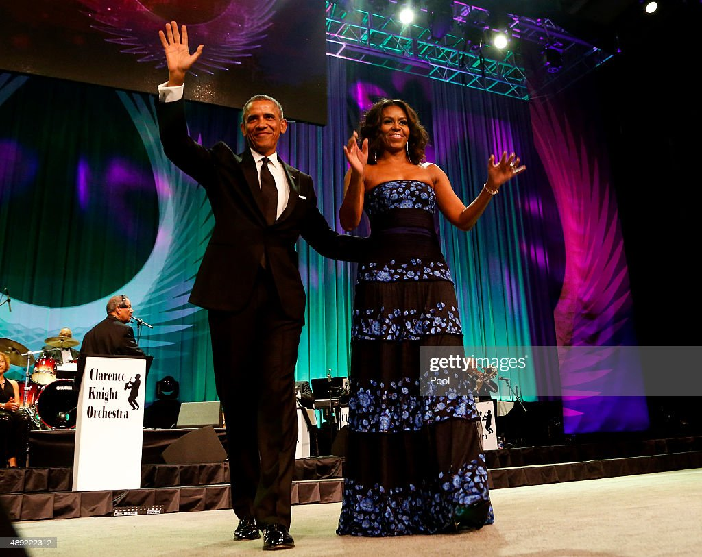 U.S. President Barack Obama and first lady Michelle Obama arrive on stage before President Obama delivers remarks at the Congressional Black Caucus Foundation's 45th Annual Legislative Conference Phoenix Awards Dinner at the Walter E. Washington Convention Center, on September 19, 2015 in Washington, DC. Obama paid tribute to female leaders in civil rights.