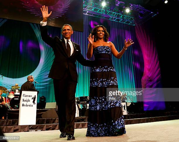 S President Barack Obama and first lady Michelle Obama arrive on stage before President Obama delivers remarks at the Congressional Black Caucus...