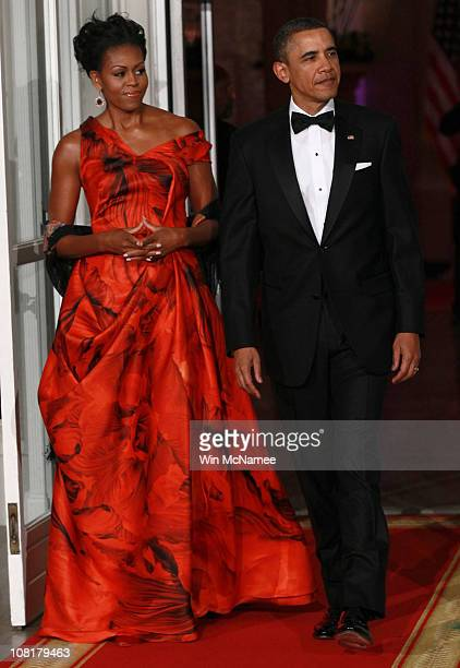 S President Barack Obama and first lady Michelle Obama arrive to greet Chinese President Hu Jintao prior to a State dinner at the White House January...