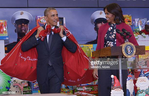 US President Barack Obama and First Lady Michelle Obama arrive to deliver toys and gifts for the Marine Corps Toys for Tots campaign on December 10...