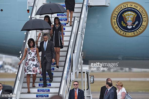 US President Barack Obama and First Lady Michelle Obama arrive with their daughters Sasha and Malia at Jose Marti international airport in Havana on...