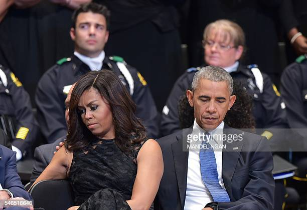 US President Barack Obama and First Lady Michelle Obama attend an interfaith memorial service for the victims of the Dallas police shooting at the...