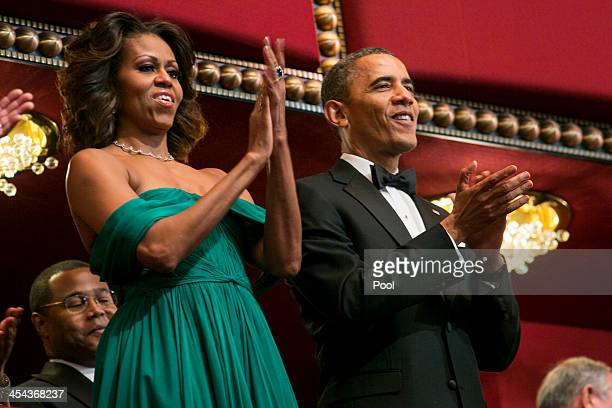 President Barack Obama and First Lady Michelle Obama attend the 2013 Kennedy Center Honors on December 8 2013 in Washington DC The honorees this year...