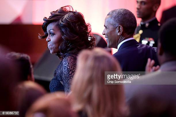 S President Barack Obama and first lady Michelle Obama attend the BET's 'Love and Happiness A Musical Experience in a tent on the South Lawn of the...