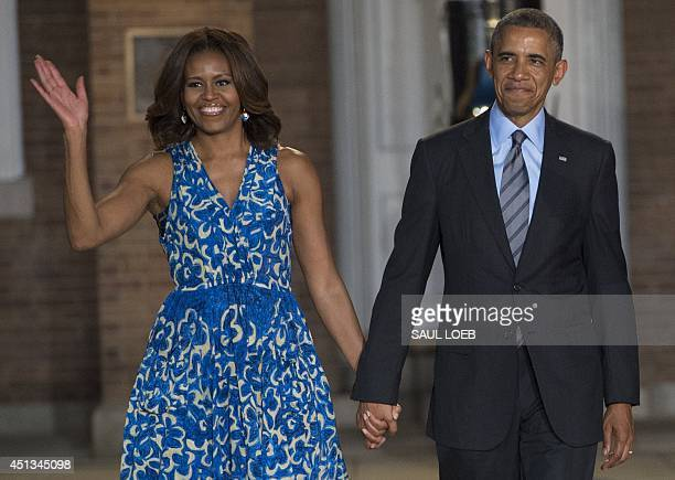 US President Barack Obama and First Lady Michelle Obama attend the Marine Barracks Evening Parade at the Marine Barracks in Washington DC June 27...