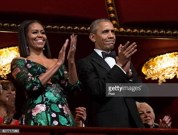 President Barack Obama and first lady Michelle Obama attend the Kennedy Center Honors show December 4 2016 at the Kennedy Center in Washington DC The...