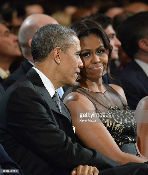 President Barack Obama and First Lady Michelle Obama attend TNT Christmas in Washington 2014 at the National Building Museum on December 14, 2014 in...