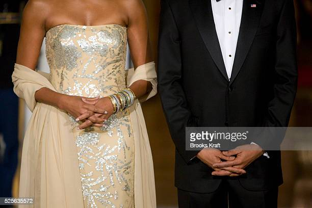 President Barack Obama and first lady Michelle Obama await the arrival of India's Prime Minister Manmohan Singh and his wife Gursharan Kaur for a...