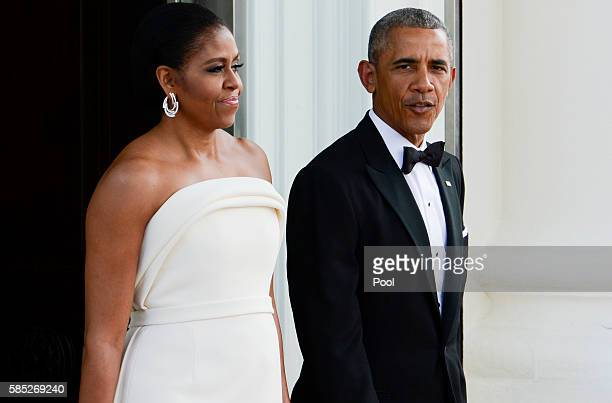 President Barack Obama and first lady Michelle Obama await the arrival of Prime Minister Lee Hsien Loong and Madam Ho Ching at the North Portico of...