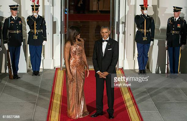 President Barack Obama and First Lady Michelle Obama await the arrival of Italian Prime Minister Matteo Renzi and Agnese Landini on October 18, 2016...