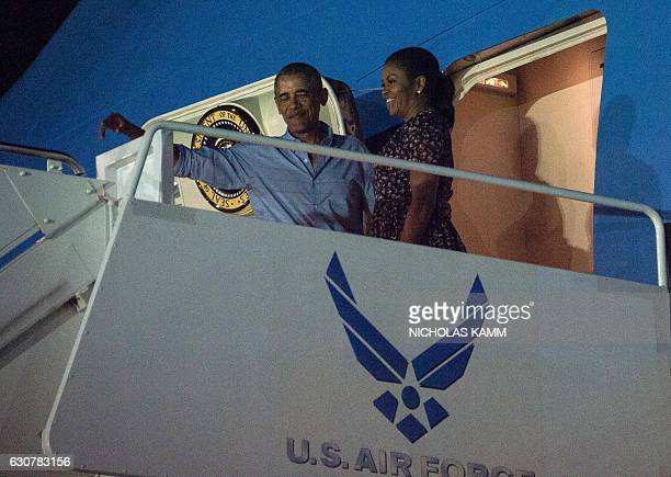 US President Barack Obama and First Lady Michelle Obama board Air Force One at Joint Base Pearl HarborHickam in Honolulu on January 1 2017 as they...