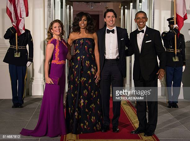 US President Barack Obama and First Lady Michelle Obama Canadian Prime Minister Justin Trudeau and his wife Sophie Gregoire Trudeau pose upon the...