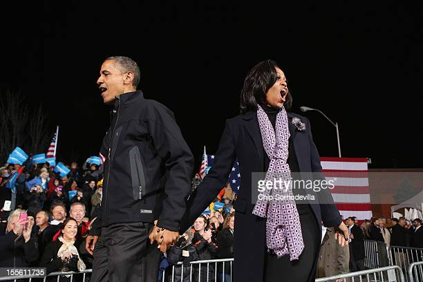 S President Barack Obama and first lady Michelle Obama cheer for their supporters during his last rally the night before the general election...
