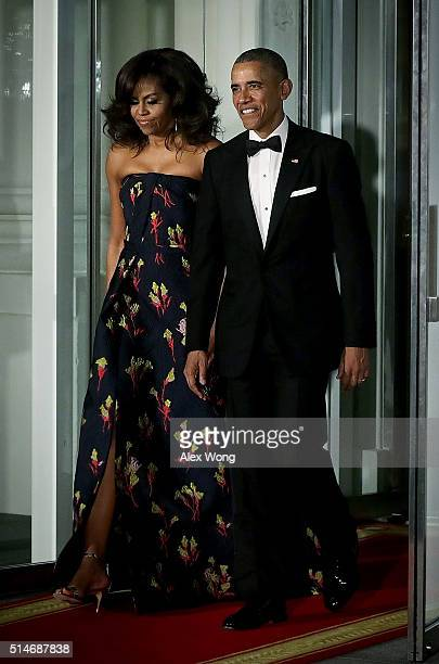 S President Barack Obama and first lady Michelle Obama come out from the White House for the arrival of Canadian Prime Minister Justin Trudeau and...