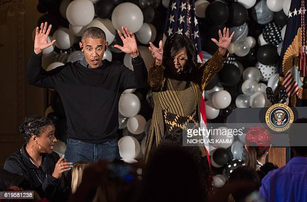 US President Barack Obama and First Lady Michelle Obama dance along with children performing Michael Jackson'n Thriller in the East Room at the White...