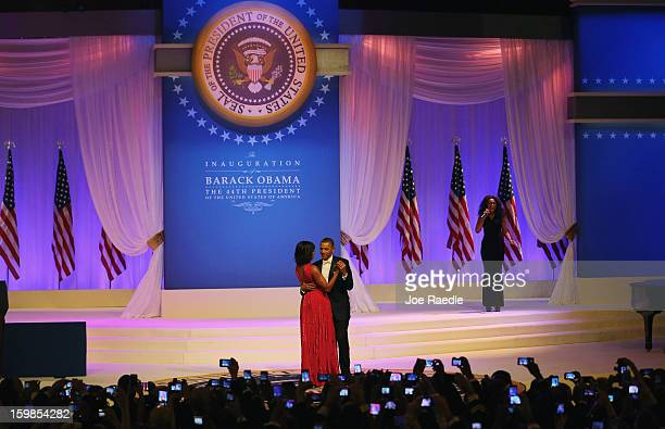 S President Barack Obama and first lady Michelle Obama dance as Jennifer Hudson sings at the CommanderInChief's Inaugural Ball January 21 2013 in...