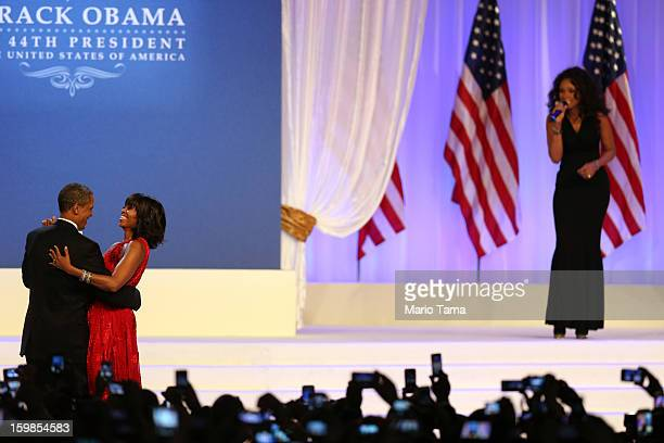 S President Barack Obama and first lady Michelle Obama dance as singer Jennifer Hudson performs Let's Stay Together during the Inaugural Ball at the...
