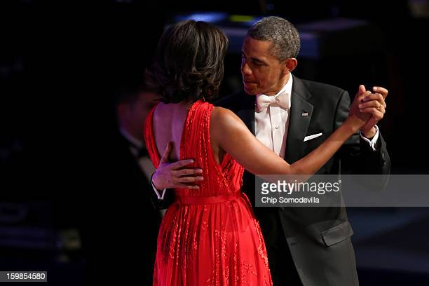 President Barack Obama and first lady Michelle Obama dance at the Commander in Chief Inaugural Ball at the Walter E. Washington Convention Center on...