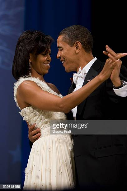 President Barack Obama and First lady Michelle Obama dance at the Biden Home State Inaugural Ball in Washington Tuesday Jan 20 2009