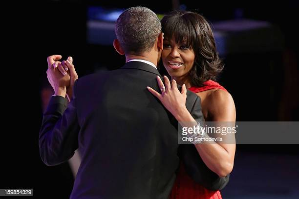 President Barack Obama and first lady Michelle Obama dance during the Commander-In-Chief Ball at the Walter Washington Convention Center January 21,...