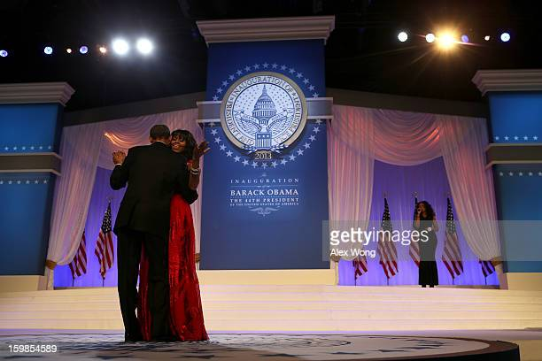 President Barack Obama and first lady Michelle Obama dance during the Commander in Chief Inaugural Ball at the Walter E. Washington Convention Center...
