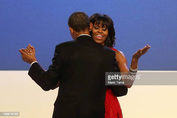 S President Barack Obama and first lady Michelle Obama dance during the Public Inaugural Ball at the Walter E Washington Convention Center on January...