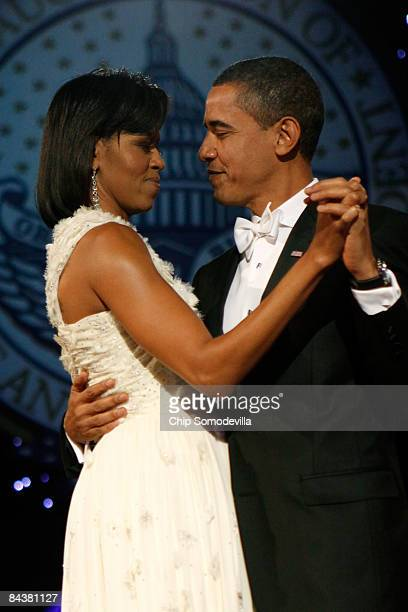 President Barack Obama and First Lady Michelle Obama dance during the Neighborhood Inaugural Ball at the Washington Convention Center on January 20...