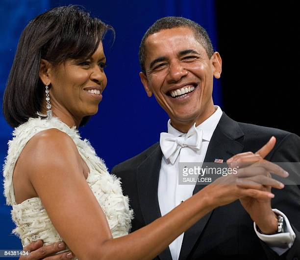 President Barack Obama and First Lady Michelle Obama dance during the Obama Home States Inaugural Ball at the Washington Convention Center in...