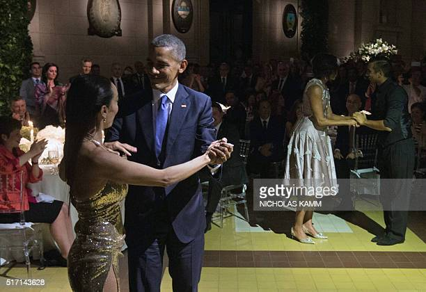 US President Barack Obama and First Lady Michelle Obama dance tango with Argentinian dancers Mora Godoy and Jose Lugones respectively during a state...
