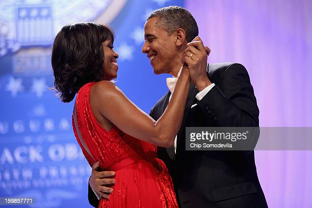 President Barack Obama and first lady Michelle Obama dance together during the Comander-in-Chief's Inaugural Ball at the Walter Washington Convention...