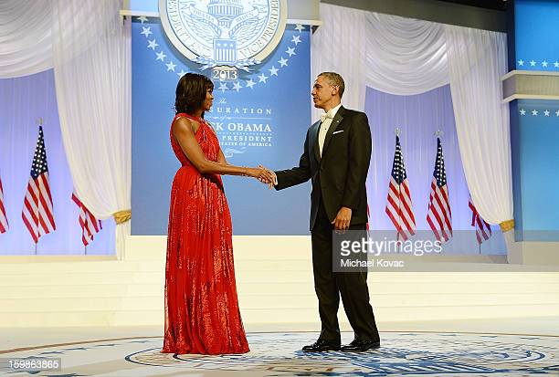 S President Barack Obama and first lady Michelle Obama dance together during The Inaugural Ball at the Walter E Washington Convention Center on...