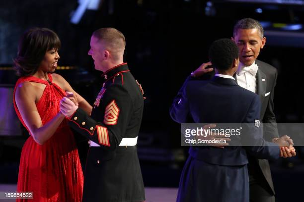 President Barack Obama and first lady Michelle Obama dance with members of the military during the Commander in Chief Inaugural Ball at the Walter E....