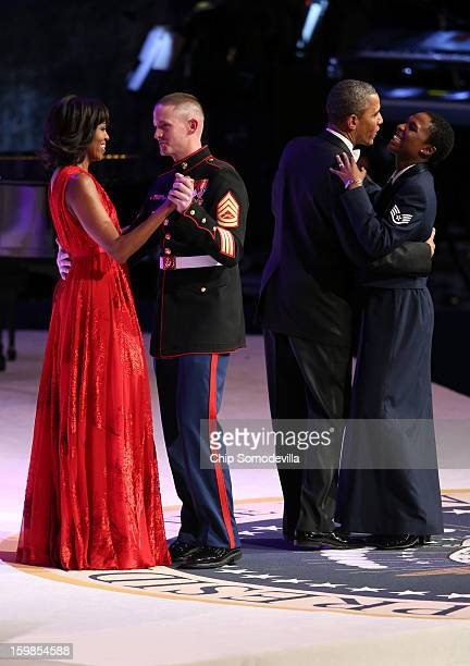 S President Barack Obama and first lady Michelle Obama dance with members of the military during the Commander in Chief Ball at the Walter E...