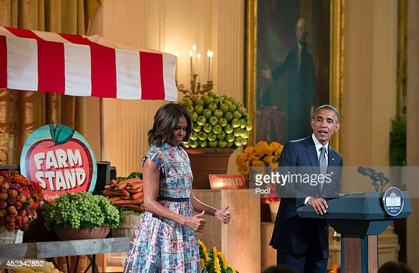 US President Barack Obama and first lady Michelle Obama deliver remarks at the Kids' State Dinner in the East Room at the White House on July 18 2014...