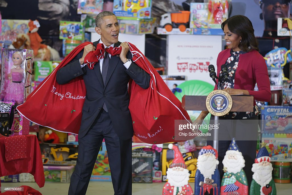 U.S. President Barack Obama (L) and first lady Michelle Obama deliver toys and gifts donated by Executive Office of the President staff to the Marine Corps Reserve Toys for Tots Program at Joint Base Anacostia-Bolling on December 10, 2014 in Washington, DC. For 67 years the Toys for Tots program has worked with local communities to collect and distribute toys and gifts for less fortunate children throughout the United States.