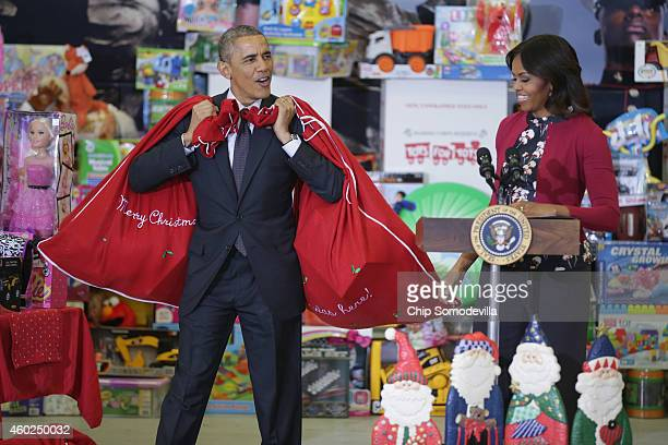 S President Barack Obama and first lady Michelle Obama deliver toys and gifts donated by Executive Office of the President staff to the Marine Corps...
