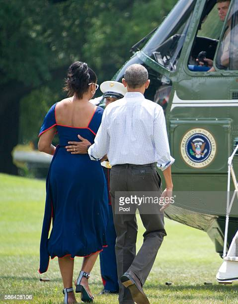 US President Barack Obama and first lady Michelle Obama depart the White House August 6 2016 in Washington DC The family is traveling to travel to...