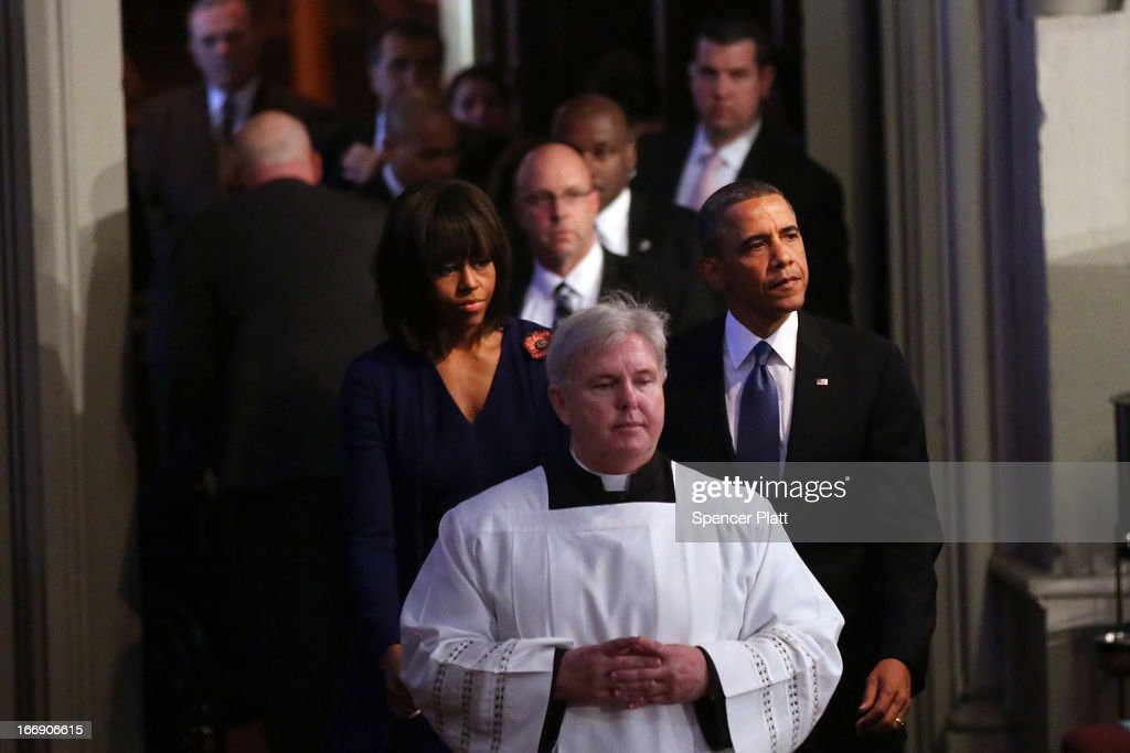 President Barack Obama (R) and first lady Michelle Obama enter an interfaith prayer service for victims of the Boston Marathon attack titled 'Healing Our City,' at the Cathedral of the Holy Cross on April 18, 2013 in Boston, Massachusetts. Authorities investigating the attack on the Boston Marathon have shifted their focus to locating the person who placed a black bag down and walked away just before the bombs went off. The twin bombings at the 116-year-old Boston race, which occurred near the marathon finish line, resulted in the deaths of three people and more than 170 others injured.