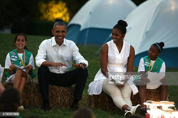 S President Barack Obama and first lady Michelle Obama flanked by Daphnye Shell of Peggs Oklahoma and Kennedi Pridget of Maryland particiapte in...