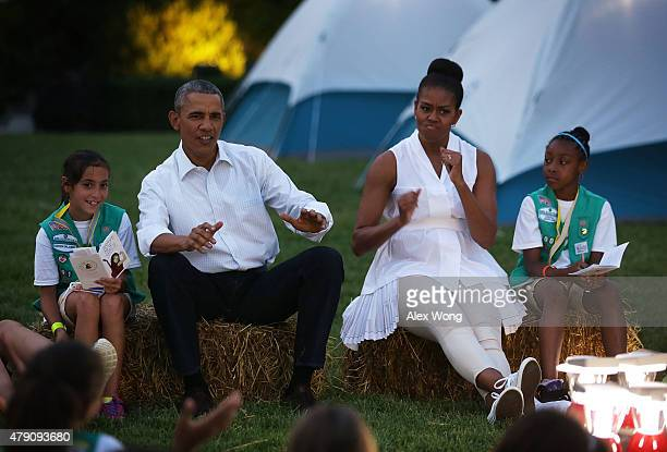S President Barack Obama and first lady Michelle Obama flanked by Daphnye Shell of Peggs Oklahoma and Kennedi Pridget of Maryland participate in a...