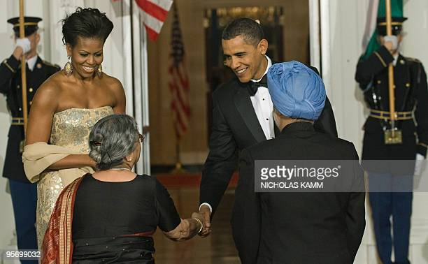 US President Barack Obama and First Lady Michelle Obama greet Indian Prime Minister Manmohan Singh and his wife Gursharan Kaur at the North Portico...