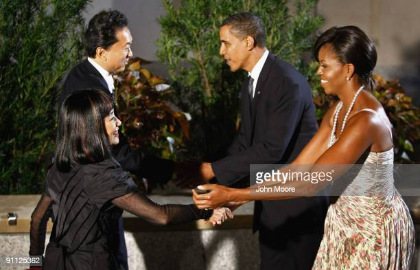 S President Barack Obama and first lady Michelle Obama greet Japanese Prime Minister Yukio Hatoyama and first lady Miyuki Hatoyama at the Phipps...