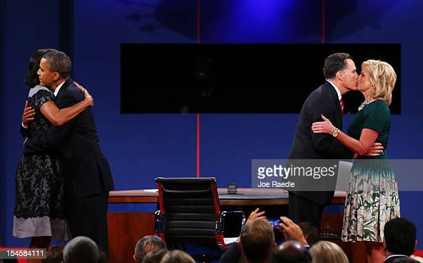 S President Barack Obama and first lady Michelle Obama greet on stage with Republican presidential candidate Mitt Romney and wife Ann Romney after...