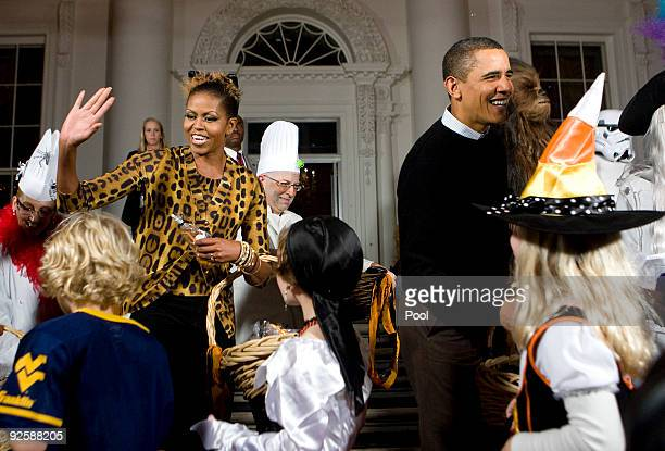 President Barack Obama and first lady Michelle Obama greet parents trickortreaters and local school children at the north portico of the White House...