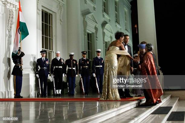 President Barack Obama and first lady Michelle Obama greet Prime Minister of India Manmohan Singh and his wife Gursharan Kaur in the North Portico of...