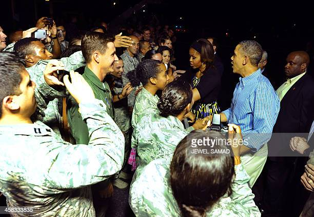 US President Barack Obama and First Lady Michelle Obama greet soldiers upon arriving at Joint Base Pearl HarborHickam in Honolulu Hawaii on December...