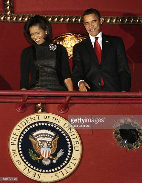 US President Barack Obama and first lady Michelle Obama greet the audience as they attend Alvin Ailey American Dance Theater's performance entitled...